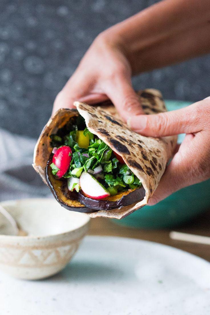Middle Eastern Eggplant Wrap with a lemony Kale Parsley Mint Slaw and Creamy Tahini Sauce. Keep it vegan or add crumbled feta! | www.feastingathome.com