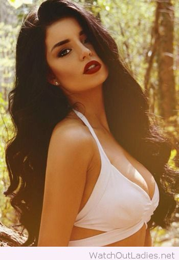 Beautiful long curly black hair with hot red lips