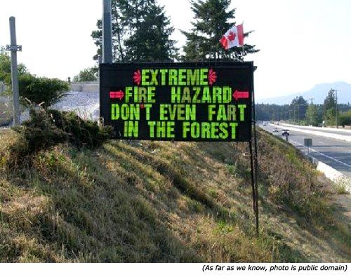 Funny and silly signs: A funny road sign saying: Extreme fire hazard. Don't even fart in the forest!