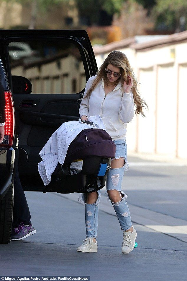 Special time: She only gave birth to her baby boy on Thursday, but Briana looked incredible when she was pictured out with her bundle of joy for the first time in LA on Wednesday