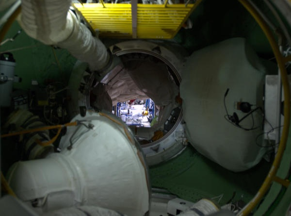 Here's the view looking through to the US Lab from inside the Russian FGB at our Robonaut in the distance.
