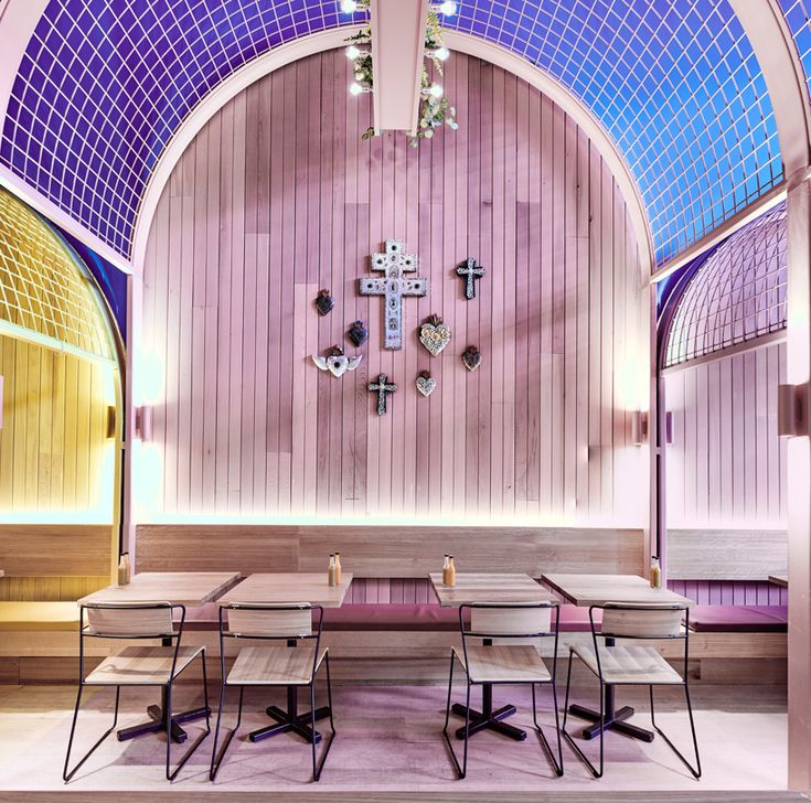 bold colors and mesh arches define the interior of techné's paco's tacos restaurant