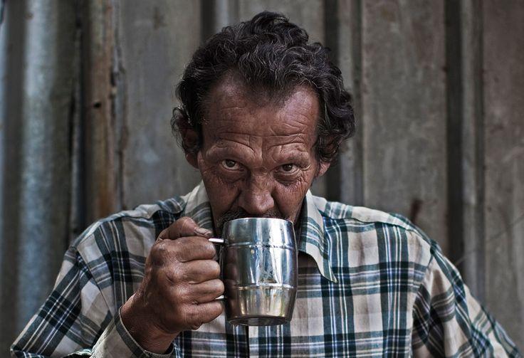 Andre Coetzee, 57, drinks a mug of coffee.
