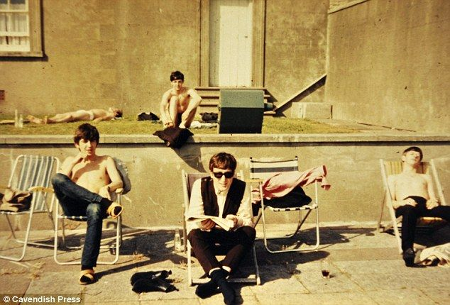 1963: Previously unseen photo (as of 2/24/12) of The Beatles basking in the Weston-Super-Mare (Somerset, England) sun after a busy few months touring around the country. In the background a pasty-looking gentleman is sunbathing in his underpants, oblivious to his famous neighbours