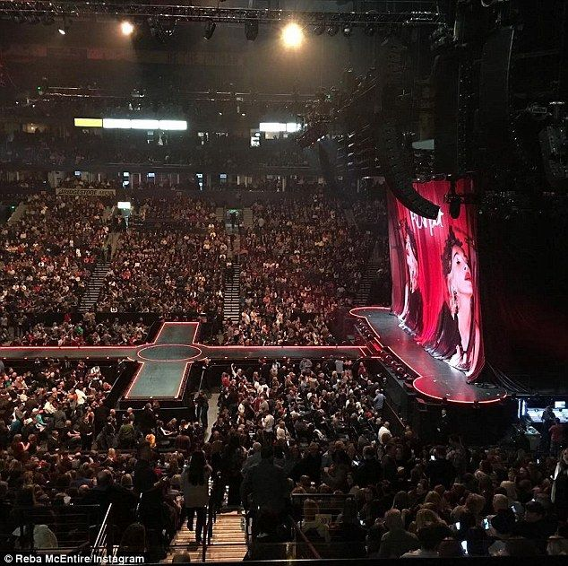 Empty stage: 'We're here!!! Where is she???' Reba captioned this photo from Nashville's Bridgestone Arena on Monday as the crowd waited 2.5 hours for Madonna