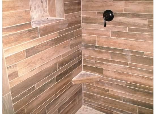 Wood Grain Tile In Shower With White River Rock Bathroom