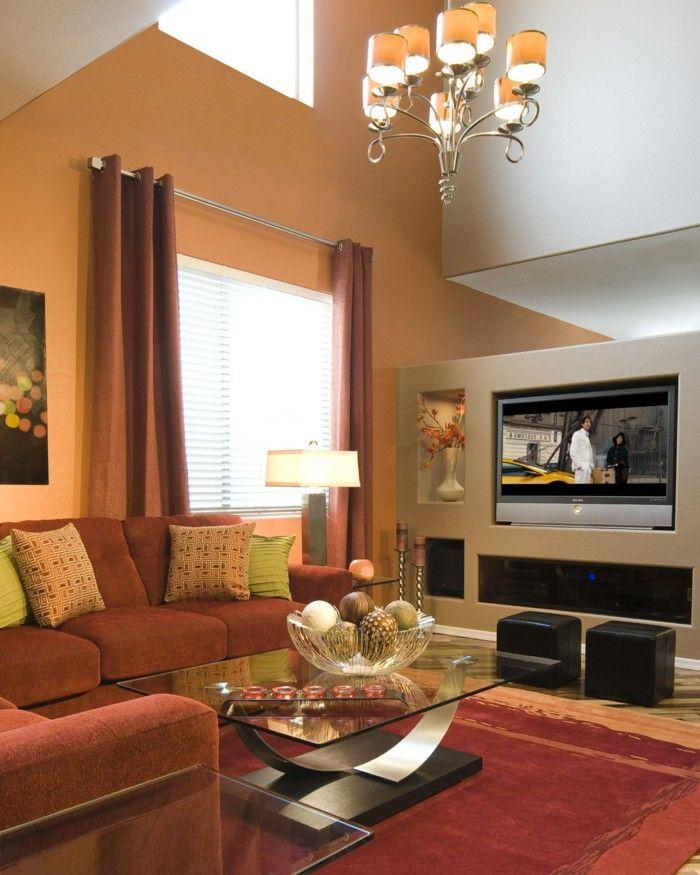 Innendesign Living Room Cozy Orange Walls Red Carpet Chandelier