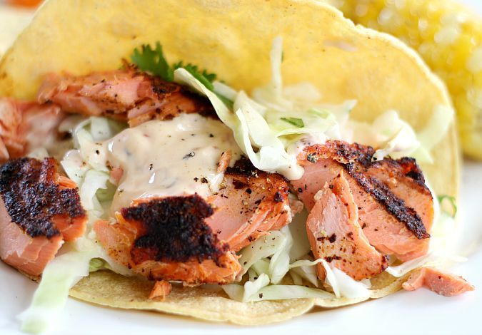 The best grilled fish tacos I've ever made combine a Baha spice rub on salmon or any firm fish, compimented by a homemade tartar sauce and cabbage slaw.