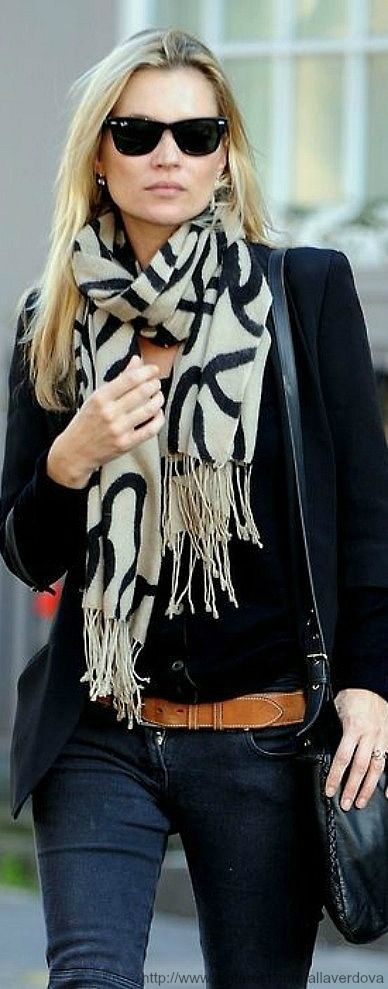 black jacket, black shirt, black and cream scarf with jeans and a brown belt