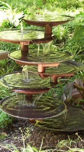 repurposed used satellite receivers bottled up designs fountain gardenfountain ideasgarden