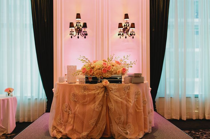 Head Table for the new Mr. and Mrs - Beautiful floral arrangement with Hydrangeas and Pink and Blush Roses http://www.fusion-events.ca/