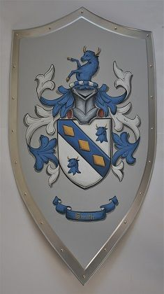 Steel medieval knight shield - shield w. family crest painted on old gray background