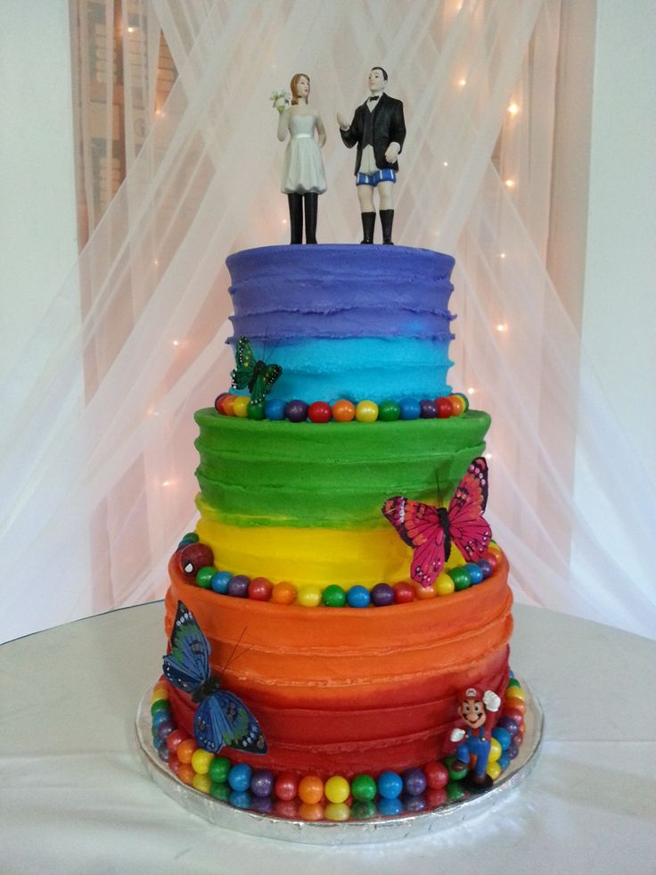 Round Wedding Cakes - Buttercream icing rainbow cake for a bride and groom with children. The butterflies, Mario and Spiderman represent each of the children