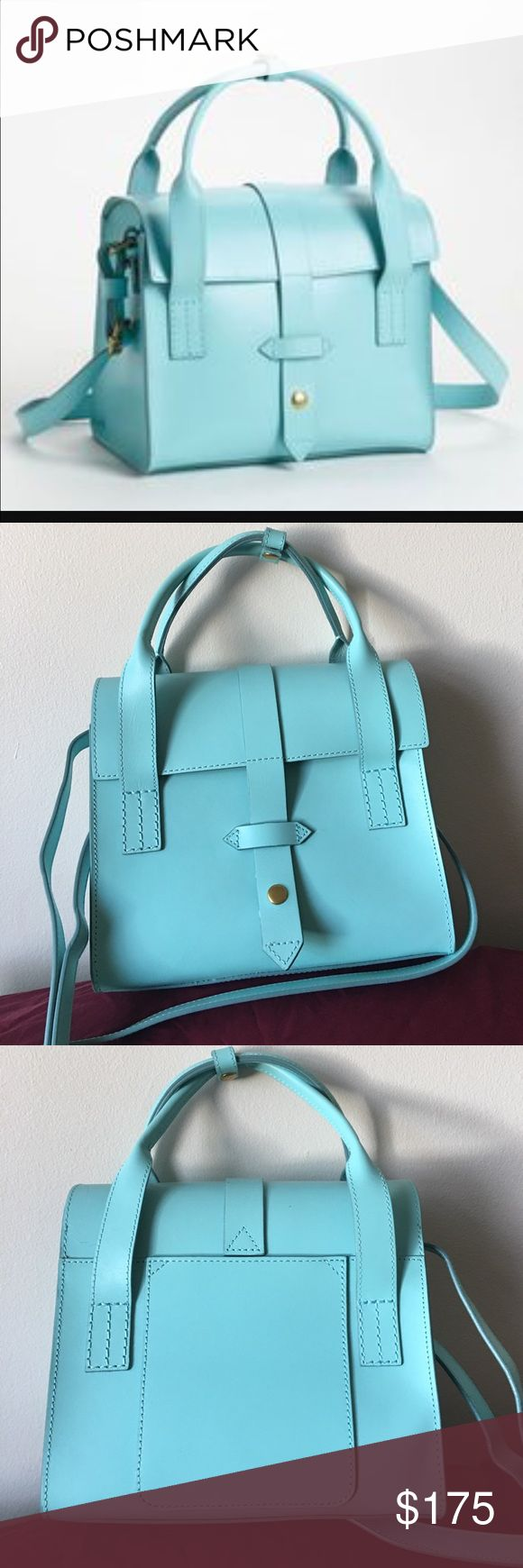 """IIIBeca by Joy Gryson Handbag Aqua Color Longtime New Yorker Joy Gryson designs the perfect everyday-bag down to a science. Case-in-point: this sturdy vachetta leather messenger bag from her IIIBeCa collection, complete with a detachable lining that converts into a spare pouch. SPECS: One outer pocket, Snap front, Leather; removable nylon lining, 8.5""""H, 10""""W, 4""""D, 19.5"""" strap drop Joy Gryson Bags"""