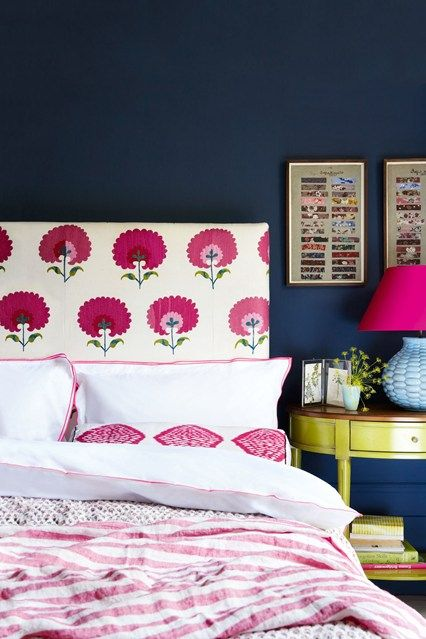 Can't find a headboard you like? Customise. Paint one directly onto the wall, create an upcycled version out of old doors, or simply cover an existing headboard in a new fabric like shown here, adding plenty of pattern throughout the room for a cosy, layered look.