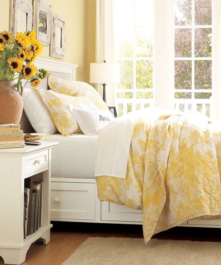 Beautiful yellow bedroom. Hate those dust collecting fake flowers but love that sunshine yellow for a child's or guest bedroom