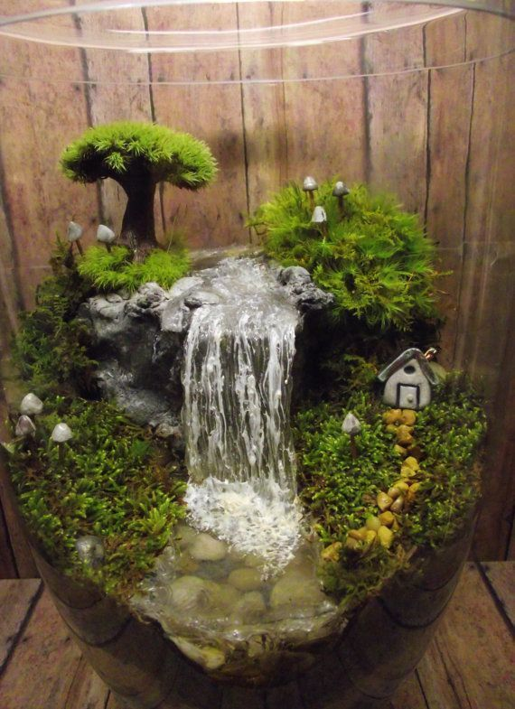 Use tiny fountain pump from Michaels with the switch hidden but exposed just on the surface to make this adorably tiny waterfall!