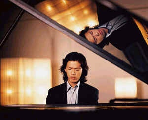 """Chinese pianist Yundi Li. In October 2000, at the urging of the Chinese Culture Ministry, Li participated in the 14th International Frédéric Chopin Piano Competition in Warsaw. He was the first participant to be awarded First Prize in 15 years. At 18 years of age, he was the youngest winner—and the first Chinese—in the competition's history. Li was given the """"Polonaise award"""" by the Chopin Society for his performance at the competition."""