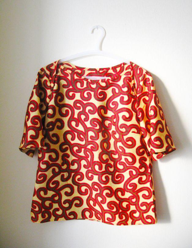 Woven t-shirt made from an African wax print fabric.