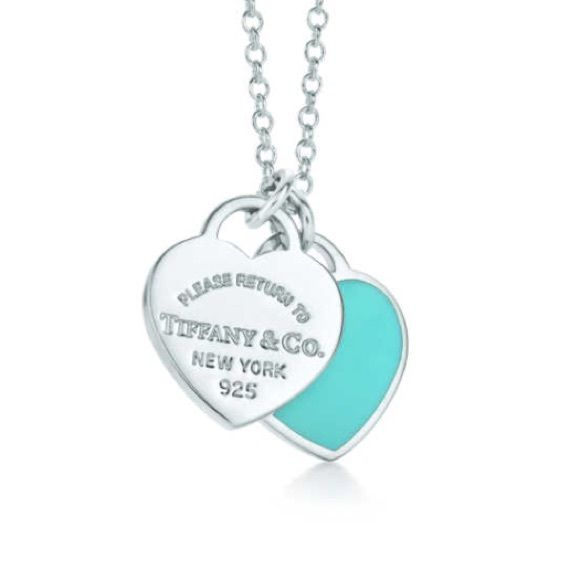 """Return to Tiffany & Co. Double Heart Tag Pendant 16"""" chain. Like new hardly ever worn and sterling silver just cleaned today. The hearts are small not like some return to tiffany necklaces. Normally a $125 necklace on Tiffany's website today. I have the small drawstring bag it came with. Very pretty delicate necklace. No trades. Make an offer! Tiffany & Co. Jewelry Necklaces"""