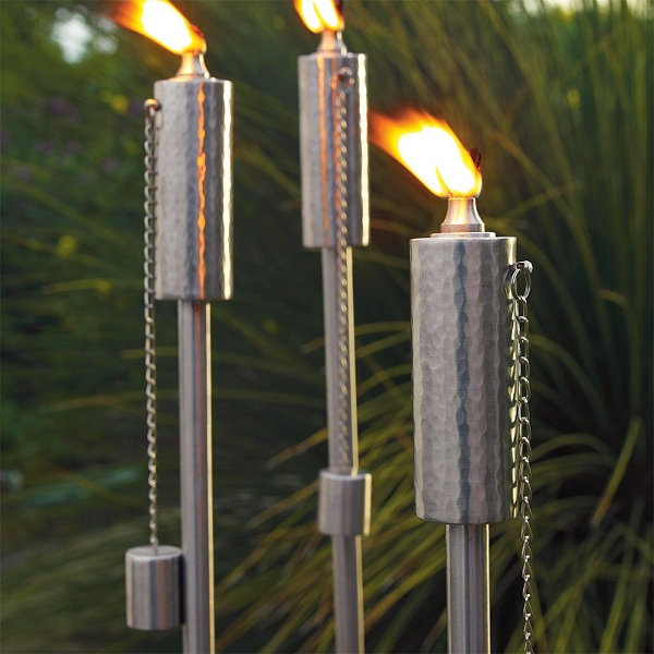 stainless torches. great for a modern backyard.