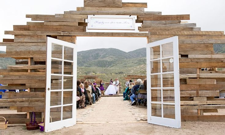 Outdoor wedding entrance.  Great way to take my love of repurposing pallet wood and create a perfect entrance to an outdoor wedding.  Old doors and staggered wood.
