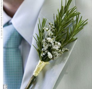 The groomsmen wore boutonnieres made of rosemary and small white flowers.