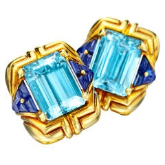 bulgari aquamarine and sapphire ear clips designed in yellow gold with a center square cut aquamarine and accented with sapphires stamped bulgari