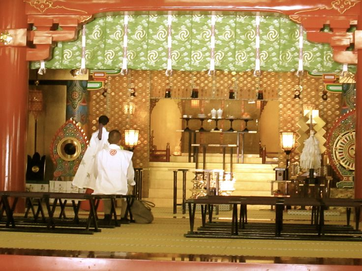 Shinto worship ceremony with priests at Meiji temple