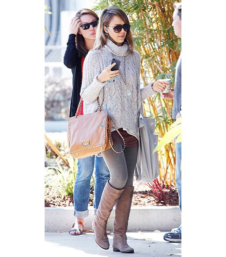 Jessica Alba bundled up for a trip to the office last week in a turtleneck sweater, gray leggings, H. Lorenzo leather knee-high boots, and Valentino bag.
