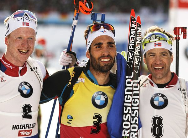 Martin Fourcade of France celebrates winning gold, Johannes Thingnes Boe of Norway celebrates silver and Ole Einer Bjoerndalen of Norway celebrates bronze in the Men's 12.5km pursuit competition of the IBU World Championships Biathlon 2017 at the Biathlon Stadium Hochfilzen on February 12, 2017 in Hochfilzen, Austria.