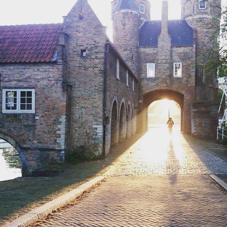 The East Gate of Delft, Oostpoort. One autumn morning when taking my kids to school, I saw this sight. Lucky to be living in such a beautiful town.