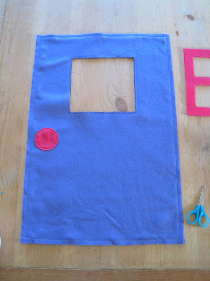 Admittedly the idea of creating a felt playhouse that slips over a card table was not an original idea but it sure is a brilliant one! Here...