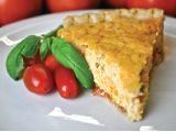 Palmetto Cheese Tomato Pie is one of our favorite dishes to serve for July 4th. Fresh garden tomatoes and Palmetto Cheese in a flaky pie crust..yum!