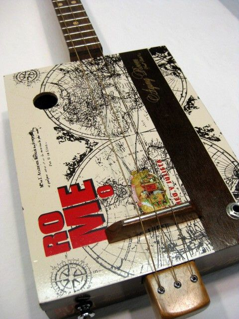 The Aging Room 3 string cigar box guitar with a Cherry Neck and a Walnut Fretboard