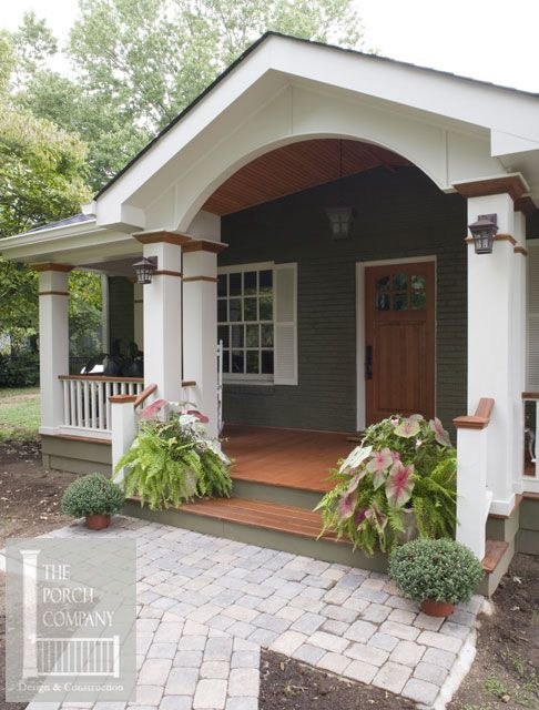 beautifully designed front porch with hip and gable roofs. love this front door