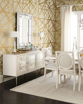 Love this dining room with gold accent wallpaper!