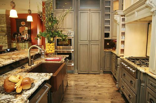 awesome kitchen with farm house sink and commercial range, built in regridgerator, double oven, wood floors. Love this!