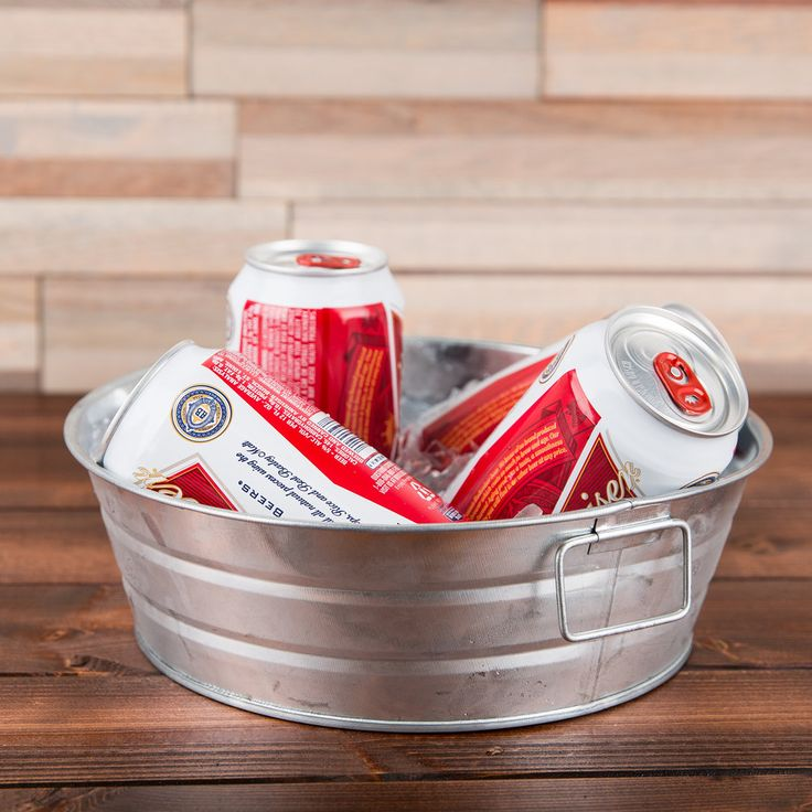Keep beverages on ice in this MTUB10 round galvanized metal tub by American Metalcraft! Simply fill it with ice and add your bottled or canned sodas, beers, and wines. Featuring a rustic galvanized metal finish and a versatile 54 oz. capacity, this metal tub is perfect for serving condiments on the buffet or self-serve line, or for displaying fresh fruit for decoration or dining. It easily adapts to any setting, making it a versatile addition to your catered event or party, too.<br><...