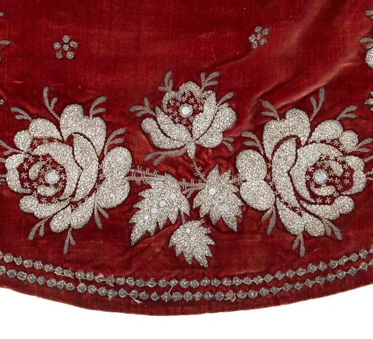 """Court train, First Empire From the Chateau de Malmaison Costume Collection app: """"This court train was found at the residence of the descendants of the family of Empress Josephine's son, Prince Eugene. It is a different type of train, not silk or tulle but velvet, and has extensive embroidery along the edges. The etiquette established under the Empire encouraged the use of such heavy, precious fabrics as Napoleon wished to revitalise the fabric manufacturing industry in Lyon."""""""