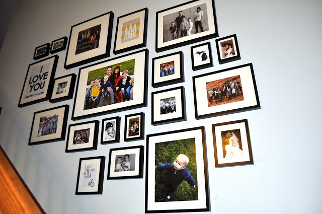 Stairway gallery wall. All IKEA frames. Only 160 dollars total. Color and black and white photos plus word art.