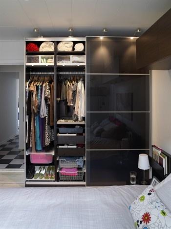 Ikea custom wardrobe sliding doors available wall for Inside wardrobe storage