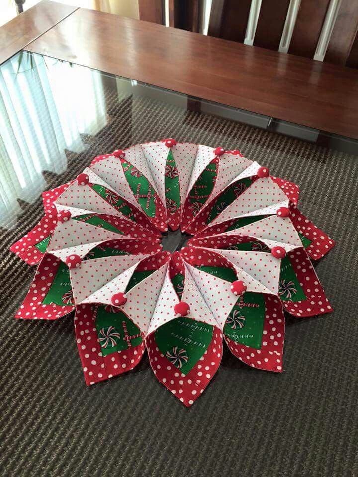 Fold'n'stitch wreath. could be done with patterned paper on the chipboard wreath