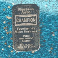This is a Western Auto silver bar. It features the famous Champion spark plug logo on the front. Obviously this was a pure silver promotion item from Western Auto.