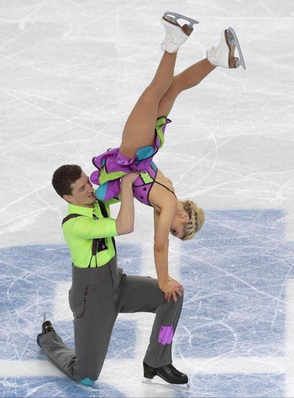 Danielle O'Brien and Gregory Merriman of Australia compete in the ice dance free dance figure skating finals at the Iceberg Skating Palace during the 2014 Winter Olympics, Monday, Feb. 17, 2014, in Sochi, Russia.