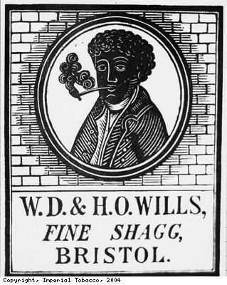 """Wrapper for WD and HO Wills' Fine Shagg tobacco.  """"Even after the freeing of slaves in America in 1865, many African Americans continued to work on the tobacco and cotton plantations where they had previously worked as slaves.� This, and the attitude to black people generally, was reflected in the continued use of the image of a black man or woman on British tobacco packaging and advertising until about 1960."""""""