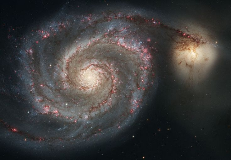 Explore the Whirlpool Galaxy and its Companion