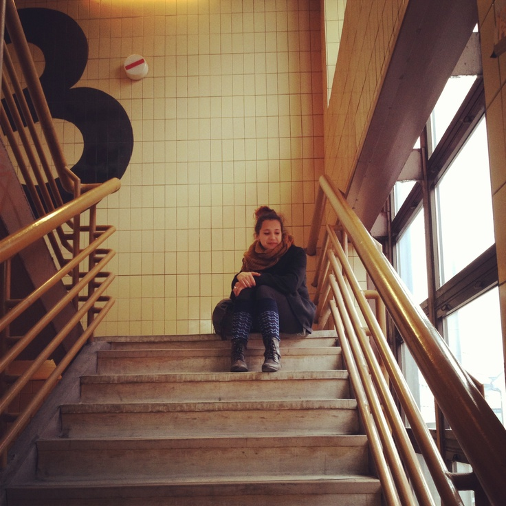 This is my friend sitting on stairs of building which may look terribly old and boring but when u look inside you see building full of memories, expectations and art which flows in veins of people who visit it.