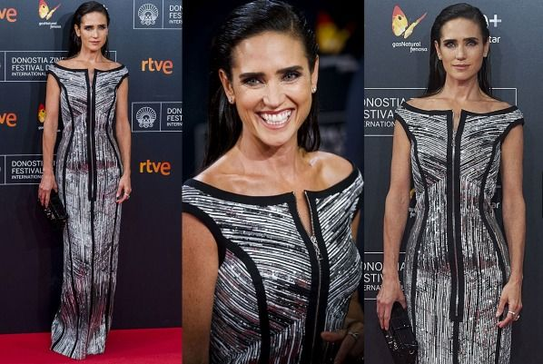 THE GOOD: Jennifer Connelly looks like she could deflect a bullet off her torso in this metallic swimsuit-on-'roids ...