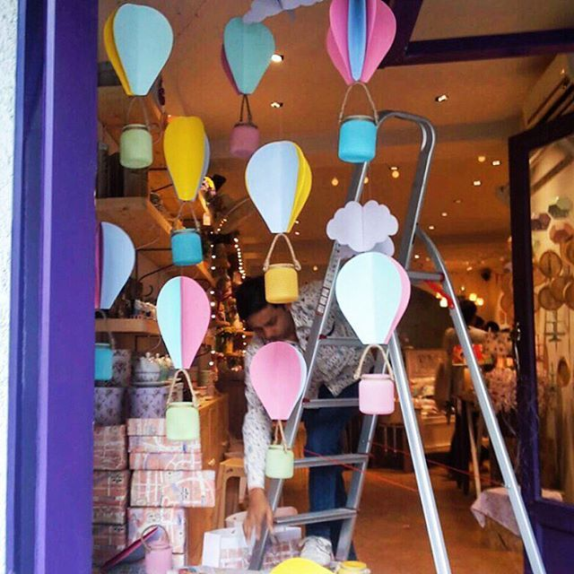 Work in progress - Our March windows  inspired by a picture perfect sky of hot air balloons. #wip #windowdisplay #hotairballoons #craftwithus #handmade #springtime